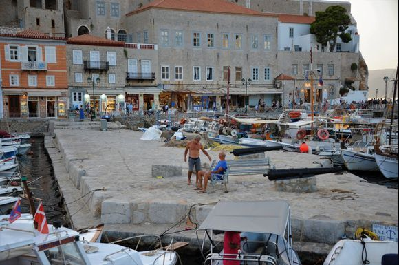 In the glow of the remnants of the sunset, we arrive at Hydra harbor after a wonderful boat trip at sunset.