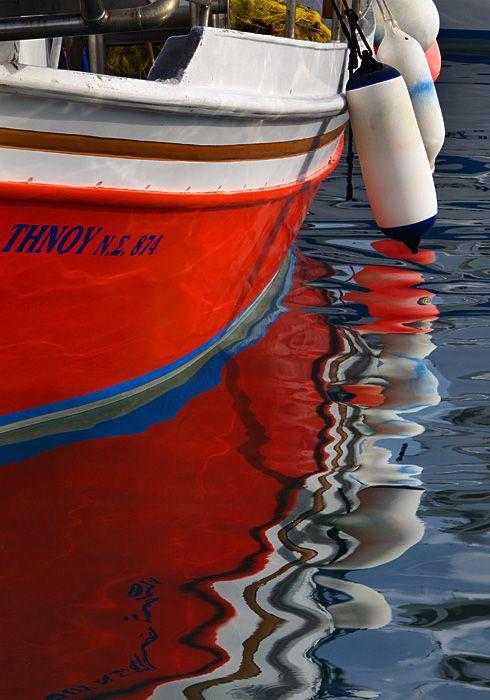 Boat reflections in Karavostasis harbour.