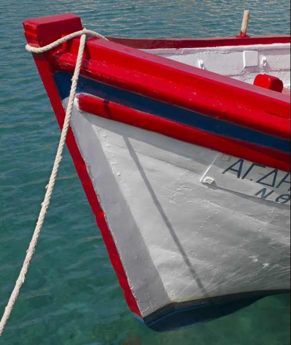 Red and white boat in Alopronoia harbour.