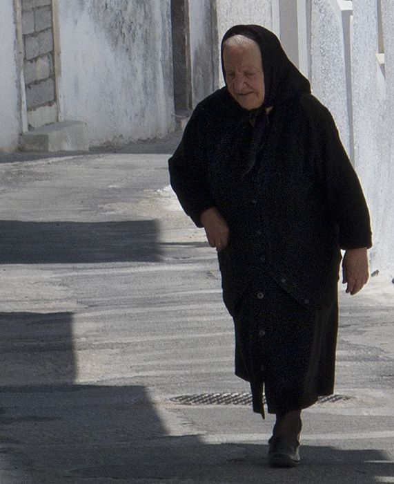 Old woman in a street in Megalochori.
