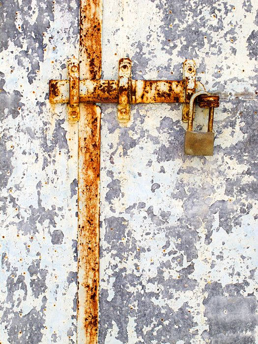 Rusty latch on door in Megalochori.