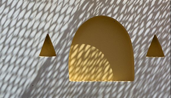 Net shadows at a cafe in Ormos Korthi