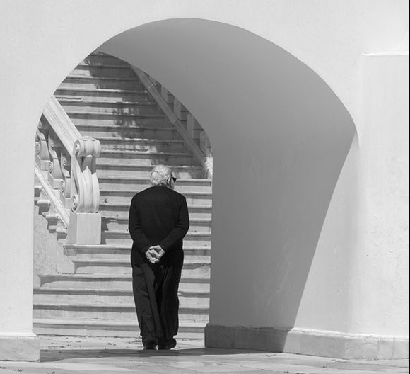 Priest in arch