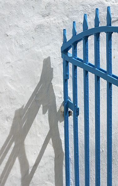 Blue gate with shadow