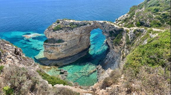 Of course you cannot visit Paxi/Paxos without seeing the famous Tripitos Arch - well worth hunting out the almost totally invisible signs and walking alllll the way down and out across the arch top!