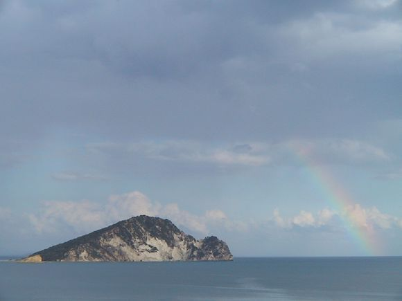 Islet of Marathonisi, famous for its sea turtles and a beautiful rainbow. It was in october.