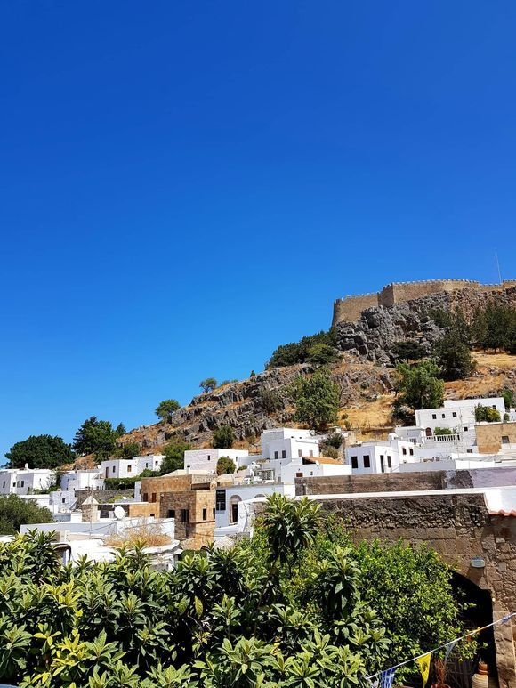 Lindos village, Rhodes island!  I really love this village, it's so picturesque!  Have you ever visited Lindos? I think that it's one of the most magical villages I 've visited so far!