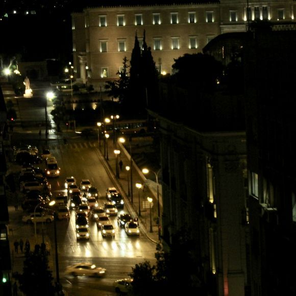 Late night traffic with the house of parliament in the background.