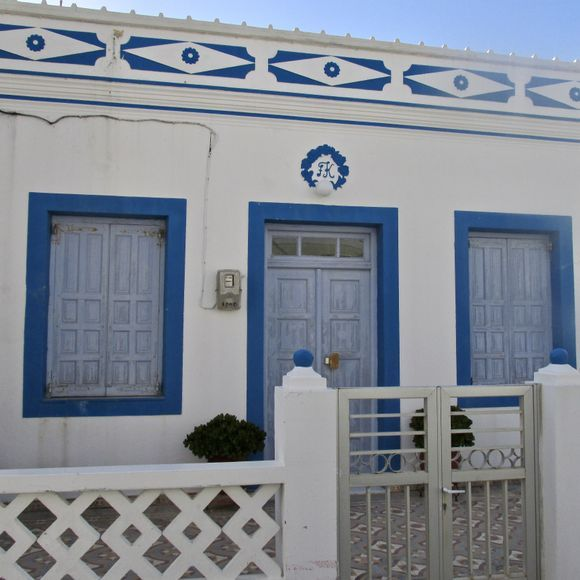 Small blue and white traditional Greek  detached house in Arkassa.