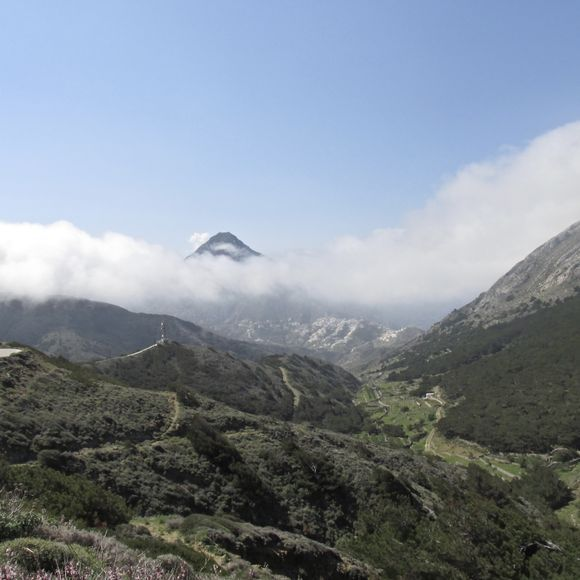 Mount Elias piercing through the clouds with Olympos below.