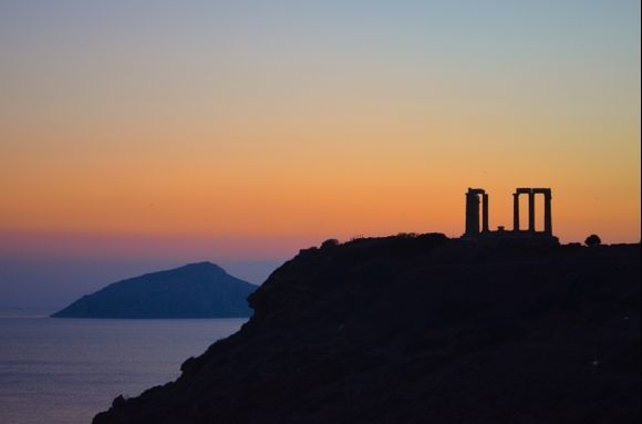 The sun already fell down behind the mountains at Cape Sounion, keeping nonetheless Poseidon's temple in the light.