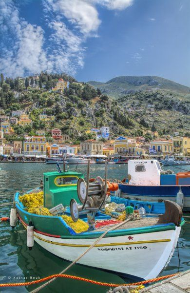 The traditional fishing boat Panormitis at the picturesque harbour of Gialos, on the island of Symi!
