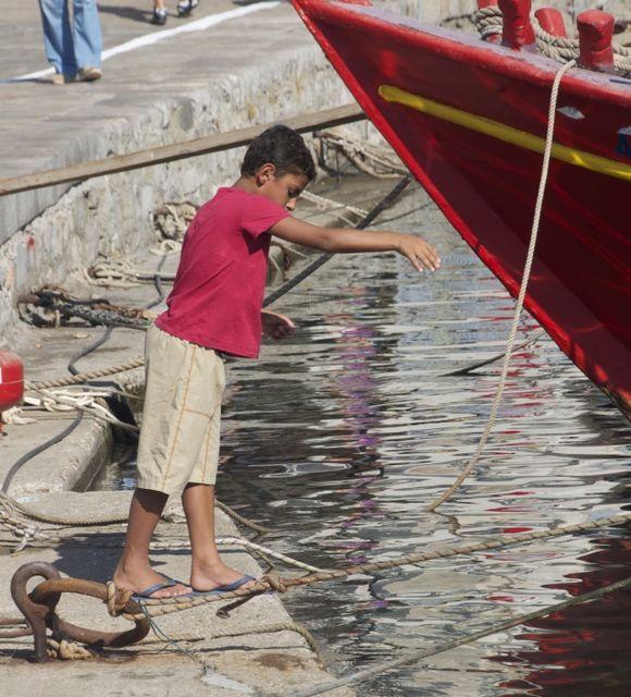 Boy fishing in Hydra harbor, July 2012.