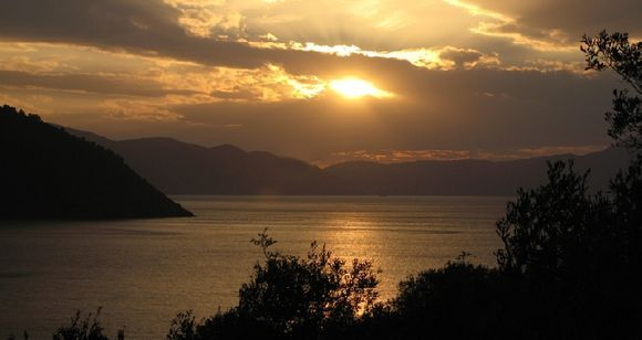 November sun over Megali Ammos looking towards the island of Skopelos in the distance