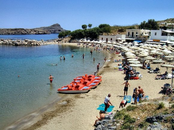 Beach at Lindos, lovely place, but a stop for almost every tourist on Rhodos.