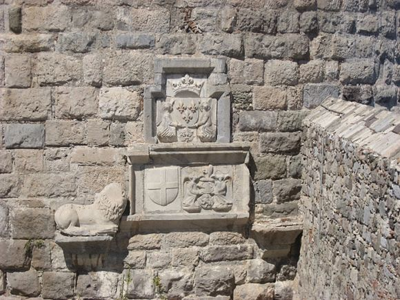 the well-known emblem of the Kingdom of France is posed on the walls of the castle of Kos, just above the coat-of-arms of the French knight - hospitaller Adimaro Du Puy, commander of the islands of Kos, Kalymnos and Leros.
