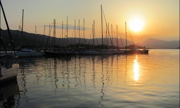 Fire and broken lines in the water... (Sunset in Poros Island. All the hills and mountains in this picture are in Peloponnesus. So close!)