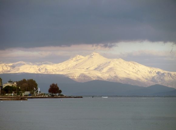 Snowy mountains of Evia as seen from Loutsa/Artemis.
