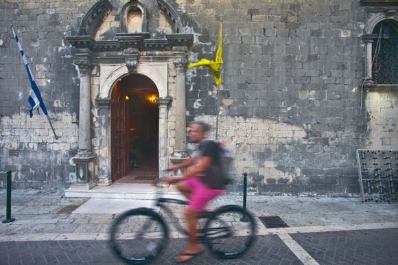 lefkada, bicycle in the city in front of the old church!
