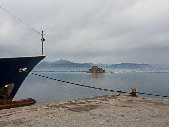 Harbor scene with Bourtzi Fortress in backgound.