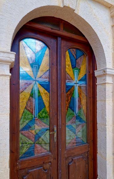 The door of a little church in stones near Vamos