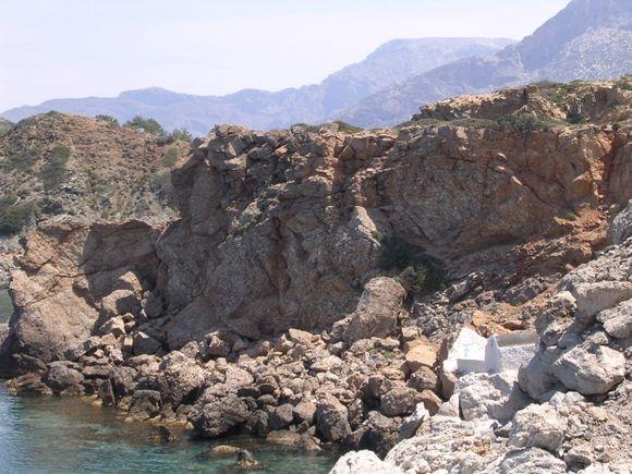White chapel hidden in Telendos cliff
