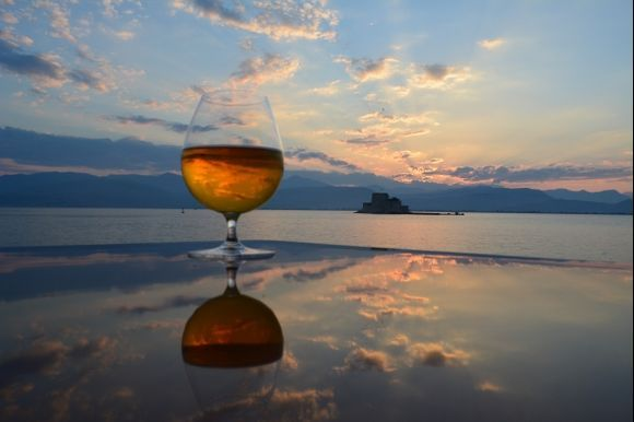 Reflection Perfection: Sunset reflection off this beautiful yachts dining table, taken in Nafplion