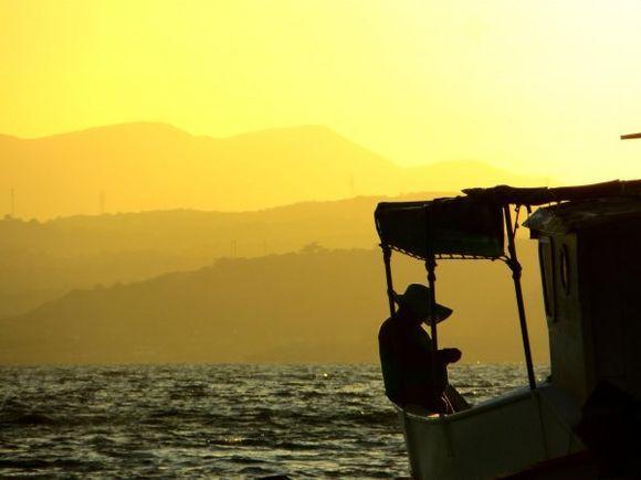 Greek Fisherman taken on a sunset photo shoot in Pefkos Rhodes.
