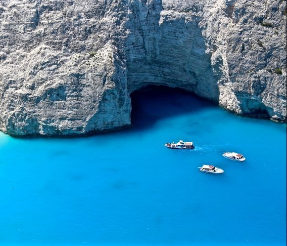 Three boats in the blue of Navagio