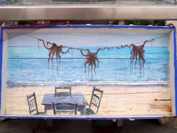 Restaurant Sign in Korissia.  This was hand-painted on a wooden serving tray displayed outside the restaurant.