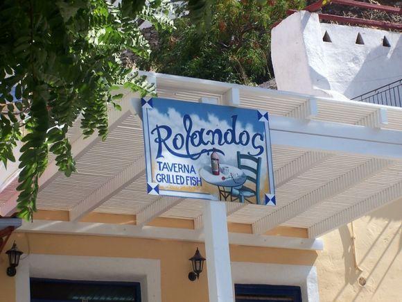 Close-up of sign for Rolandos