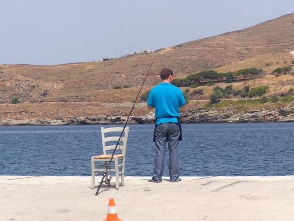 Catch of the Day in Korissia.  This was one of the restaurant waiters trying to catch a fish to serve for lunch or dinner.