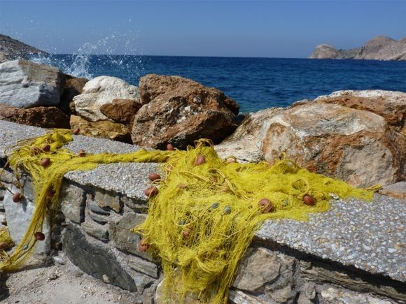 Nets drying on the harbour wall at Galissas on Syros, September 2012