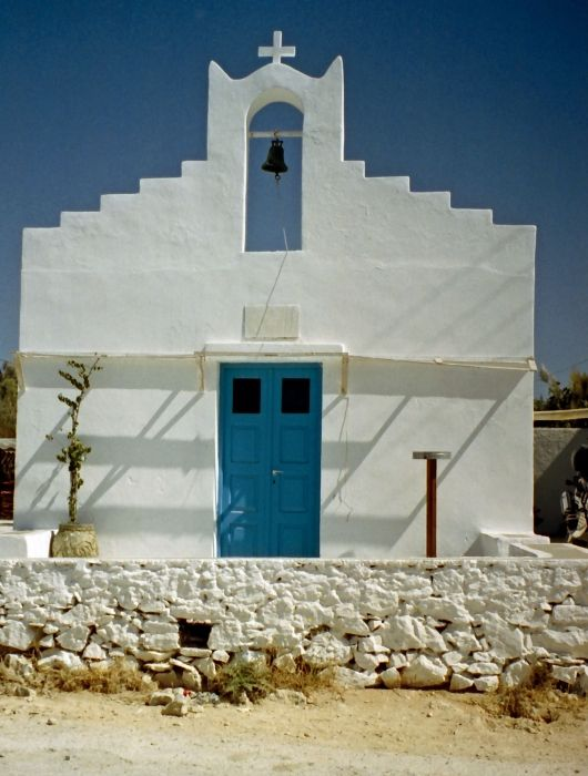Pounta chapel. In tyhe old days open doors here gave a signal to Antiparos that a ferry was wanted.
