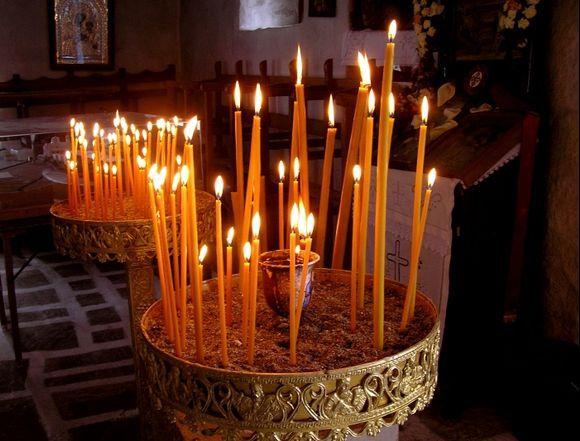 Candles lit in Panagia Argokiliotissa