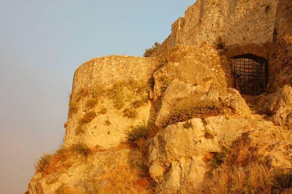 rock of angelokastro at sunset