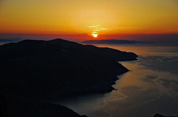 sunset behind of Milos