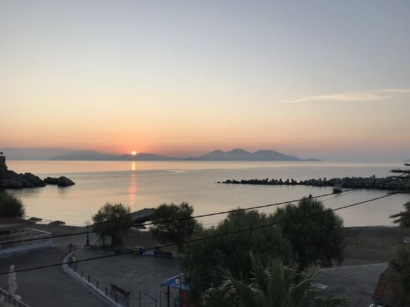 Sunrise in Therma.In the distance is Fourni Island
