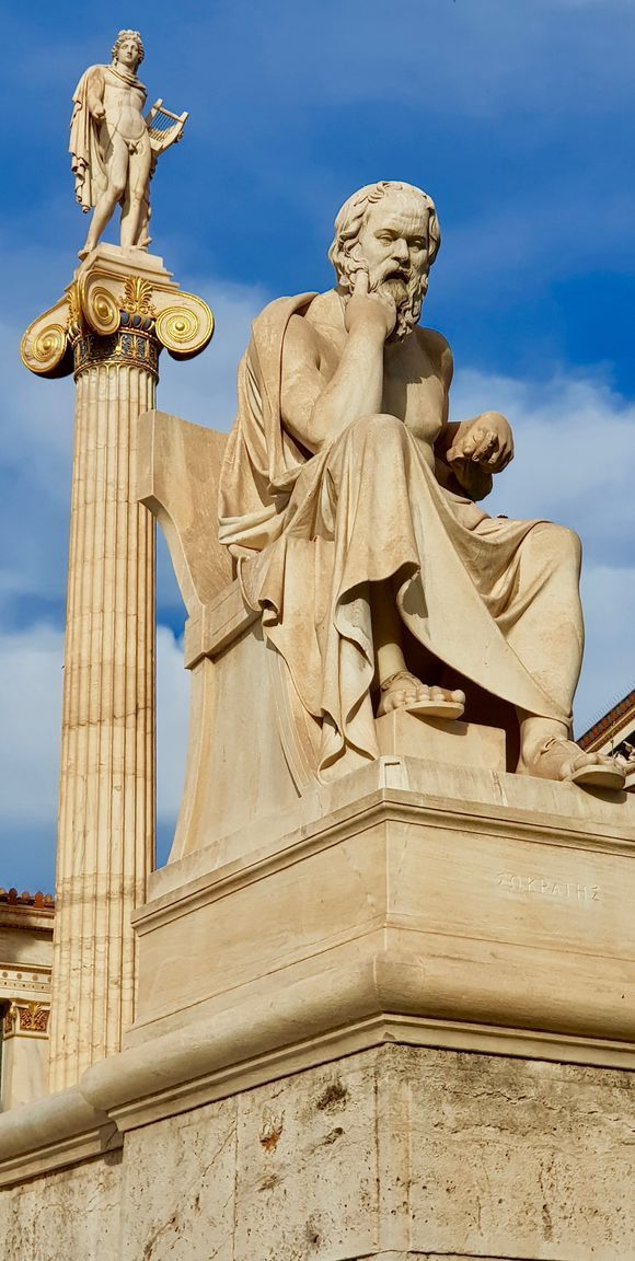 Statue of Socrates with the Apollo column in the background