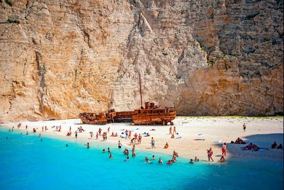 The Navagio beach in Zakynthos is one of the most photographed sites of Greece. Amazing turquoise waters, pure white sand and this huge rusted shipwreck makes this place simply spectacular. The only way you can reach it is by boat, since the location is really secluded and there is no road on the island leading there. Check here the boat tours to the Navagio beach: https://www.greeka.com/ionian/zakynthos/tours/