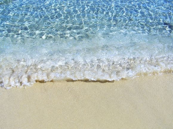 Crystal clear water at Psarrou Beach.