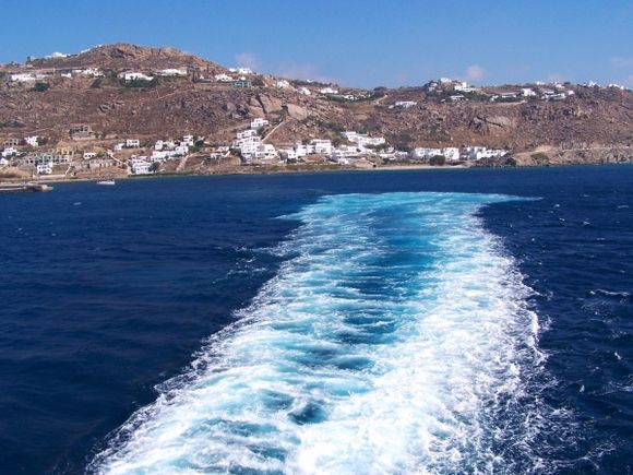 I love the color of the glowing blue wake as the awesome Blue Star Ferry waves goodbye to Mykonos.