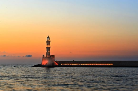 Light house at Chania(Xania) harbor and the beauty of sunset