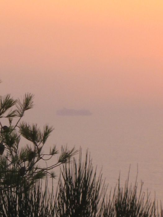 Ship in the misty sunset from Kambi