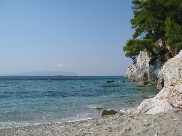 Kastani beach, with its good bathing and lovely clean water .. even though you can hear the loud-speaker music even in the water.  You can lie on your back and watch the pine trees against the beautif