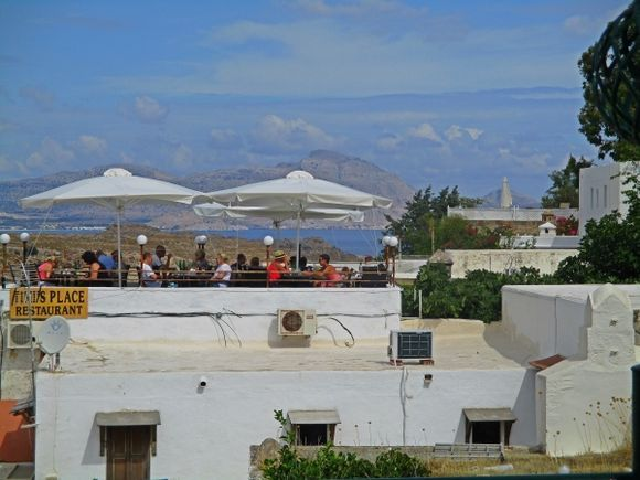 From one roof to another in Lindos town.