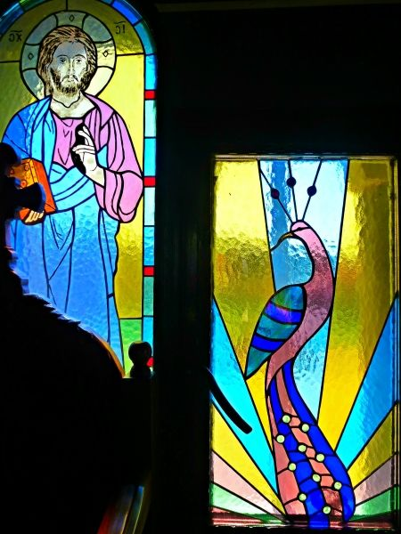 Beautiful stained glass windows in St Apostolos Church in Falaraki