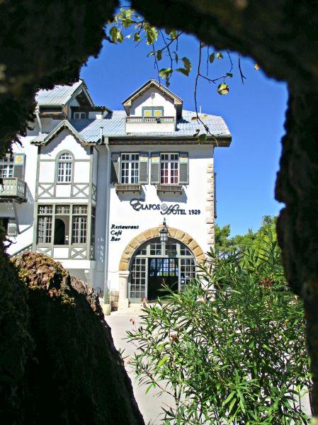 Through the tree hole!   The Elafos hotel on top of Mt. Profitas Elias