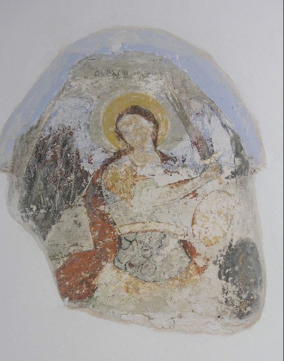 Old fresco at the entrance to the church of the Panayia of Tinos