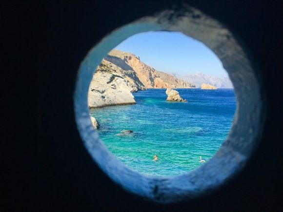 View trough the window of a beach changing cabin